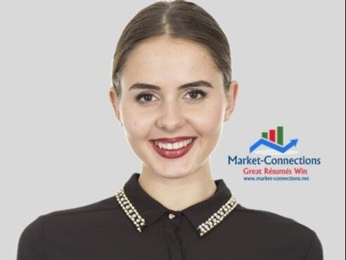 A lady is smiling and there is a log of https://www.market-connections.net in the background